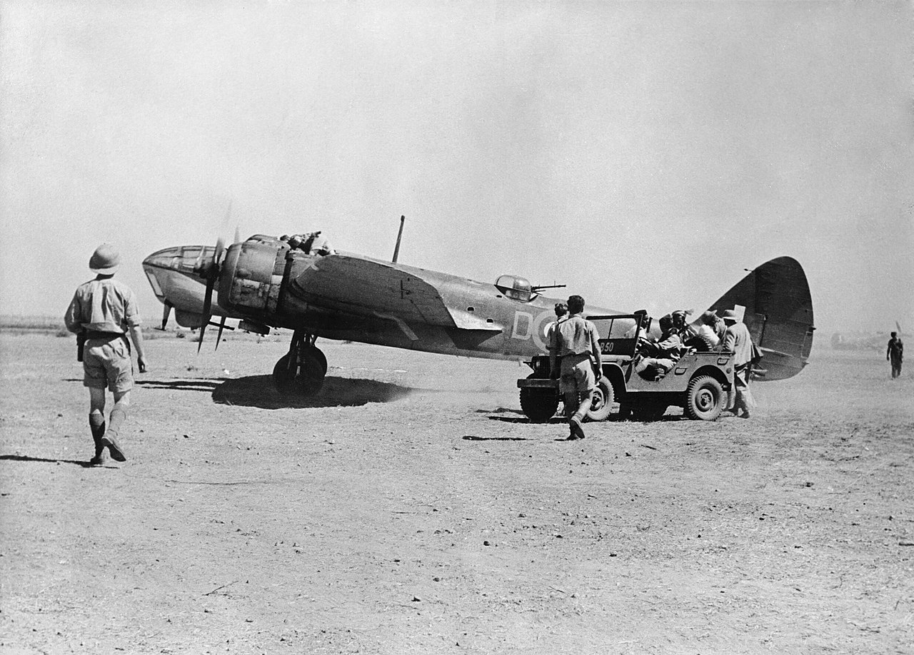 A Bristol Blenheim Mark IV of No. 45 Squadron RAF, on the ground at Magwe, Burma, while operating as part of 'X' Wing/'Burwing'. Note the jeep (right), borrowed from the American Volunteer Group, units of which were also based at Magwe in the closing stages of the first Burma Campaign