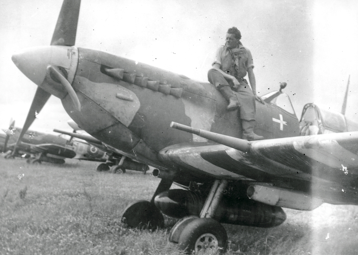 Fg Off. Jørgen Kjeldbæk sitting on the cowling of a Spitfire V; presumably Spitfire Vb AB989/SD-C, which he flew on D-Day. © Museum of Danish Resistance.