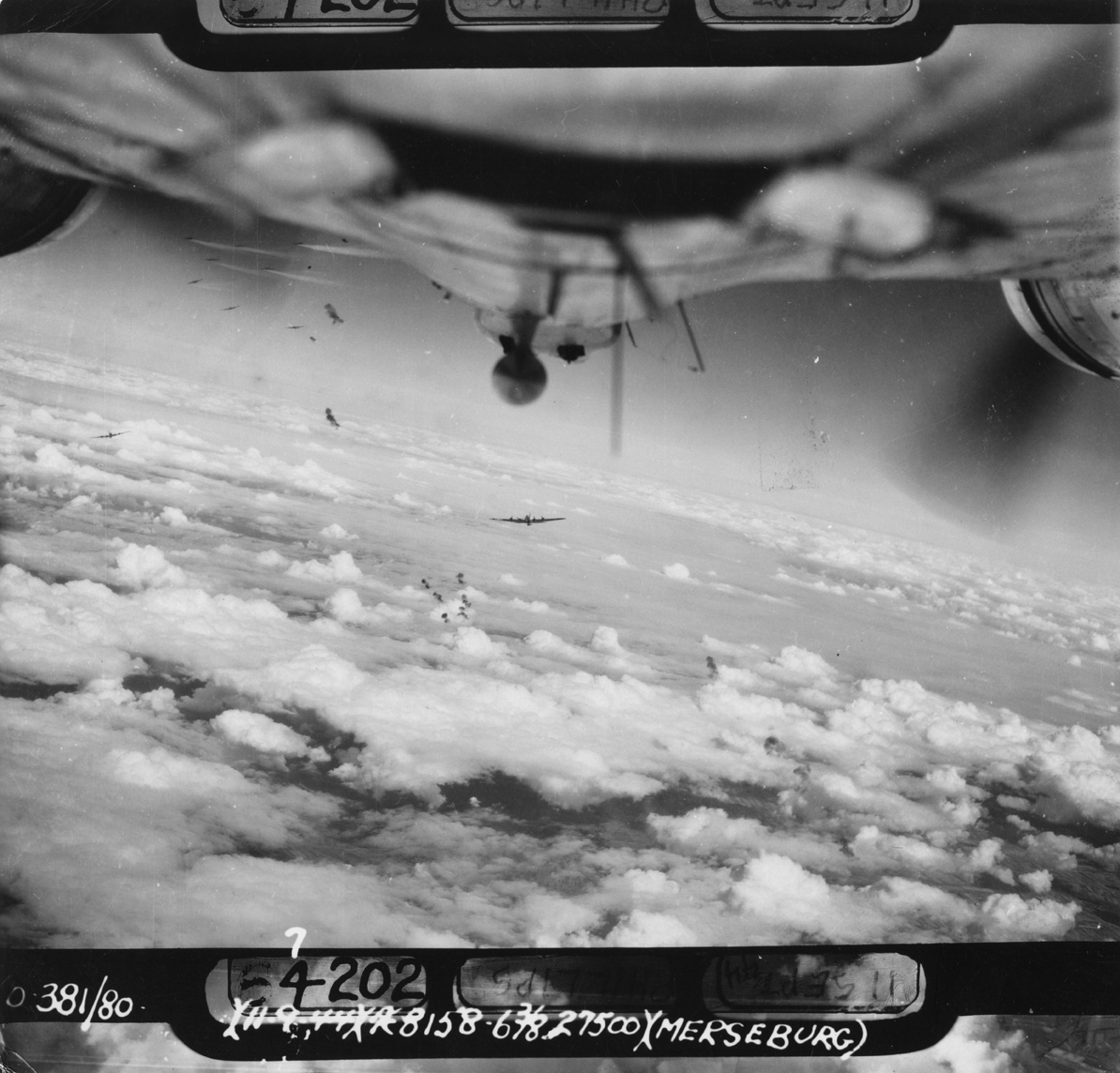 B-17 Flying Fortresses of the 381st Bomb Group fly through flak during a mission over Merseburg. Photographed from a B-17. Even if this is not related to Walter E. Poulsen, his view from the ball turret must have been similar. (© IWM, FRE 4857)